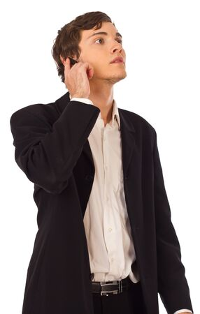 Young attractive business man touching headset looks little worried Stock Photo