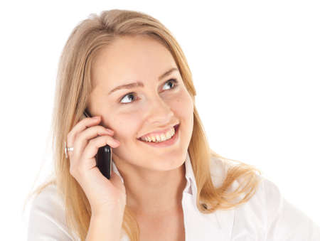 Young business woman smiling and holding phone looking up Stock Photo - 9669167