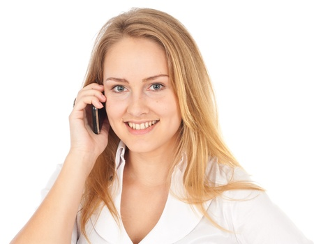 Young business woman smiling and holding phone looking straight at camera