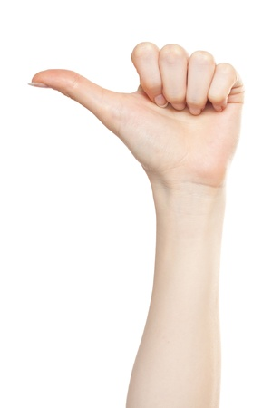 Woman hand pointing left with a thumb Stock Photo - 9885135