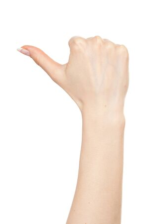 Woman hand pointing left with a thumb Stock Photo - 9885113
