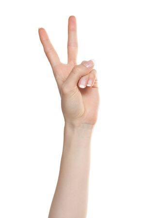 Woman hand showing number two or victory gesture photo