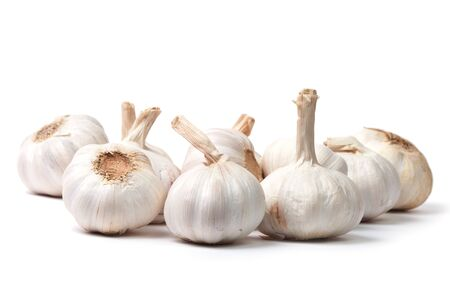 Bunch of garlic bulbs isolated on white background with shadow Stock Photo