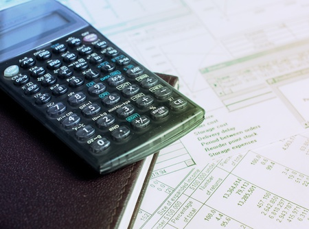Accounting with calculator and financial charts photo
