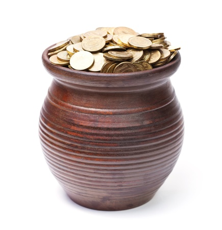 Pot of golden coins on white background photo