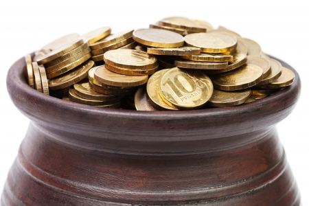 golden coins: Close up of golden coins in a pot Stock Photo