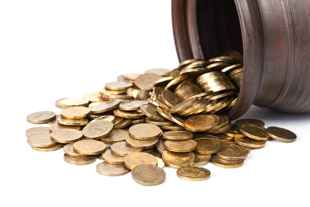 coin toss: Golden coins falling out from pot close up on white background