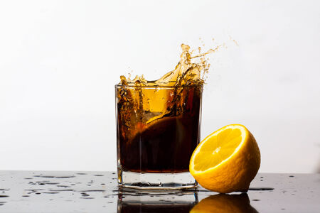 Splashing drink of Cola photo