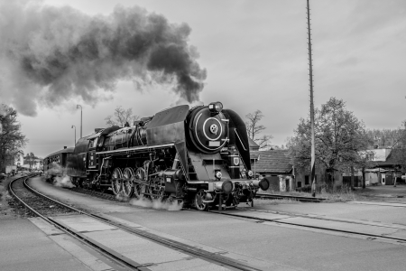 Old steam train in black and white photo