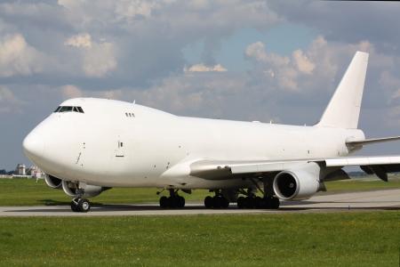 White cargo plane taxi for take off