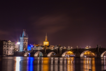Charles bridge in night in Prague photo