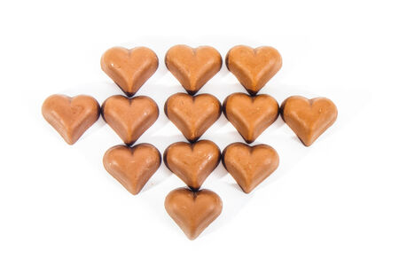 Chocolate hearts for Valentine�s day on white background photo