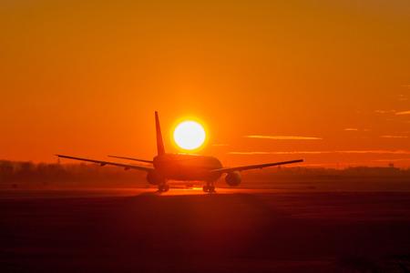 Black plane take off during sunset photo