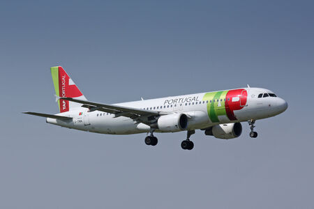 PRAGUE - APRIL 12  TAP Airbus A320 airliner lands on April 12, 2009 in Prague, Czech Republic  TAP Portugal, founded 1945 as Transportes Aà ©reos Portugueses, commonly known as TAP