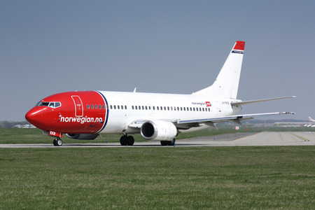 PRAGUE, CZECH REPUBLIC - APRIL 12  Norwegian Air Shuttle Boeing 737 taxis for take offt PRG Airport on APRIL 12, 2009  Norwegian Air Shuttle is the third largest low-cost carrier in Europe