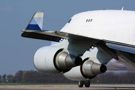Detail of huge cargo plane wing and engine