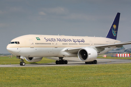 PRAGUE - JULY 20: B777 Saudia Arabia taxi to takes off PRG in Prague, Czech Republic on July 20, 2010. .Saudi Arabian Airlines operating as Saudia is the flag carrier airline of Saudi Arabia. Редакционное