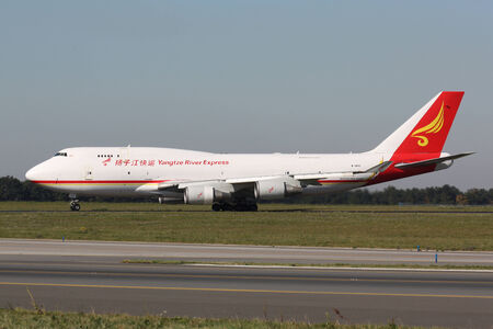 converted: PRAGUE - OCTOBER 02: Yangtze River Express Boeing 747 takes-off from Vaclav Havel Prague Airport on October 02, 2011. It is a converted freighter by Israel Aerospace Industries. Editorial