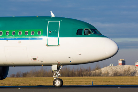 Detail of green plane nose during taxi on taxiway photo