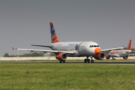 ceased: PRAGUE, CZECH REPUBLIC - AUGUST 19: Aircraft operated by Wind Jet, take off PRG in Prague on Augutst 19, 2011. On 11 August 2012, the airline has ceased operations.