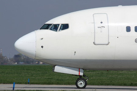 nose close up: Detail of nose white plane during taxi for take off