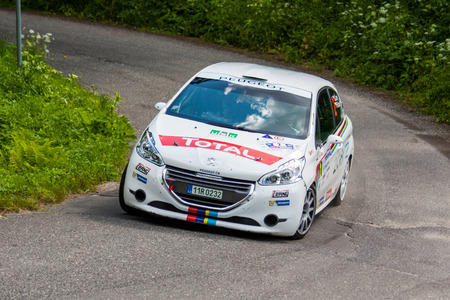 irc: MLADA BOLESLAV, CZECH REP. - JULY 13 : Driver Cerny J. and co driver Kohout P. in Peugeot 208 R2 at speed stage no. 4 during Bohemia Rally July 13, 2013 in Mlada Boleslav, Czech Republic.
