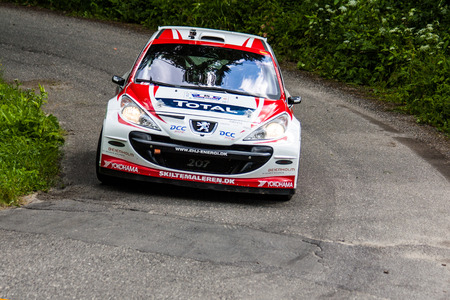 irc: MLADA BOLESLAV, CZECH REP. - JULY 13 : Driver Hegelund E. and co driver Isaksen K. in Peugeot 207 S2000 at speed stage no. 4 during Bohemia Rally July 13, 2013 in Mlada Boleslav, Czech Republic.