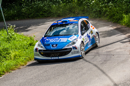 irc: MLADA BOLESLAV, CZECH REP. - JULY 13 : Driver Dohnal J. and co driver VenclÂk J. in Peugeot 207 S2000 at speed stage no. 4 during Bohemia Rally July 13, 2013 in Mlada Boleslav, Czech Republic