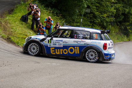 irc: MLADA BOLESLAV, CZECH REP. - JULY 13 : Driver Pech V. and co driver Uhel P. in Mini John Cooper Works S2000 at speed stage no. 7 during Bohemia Rally July 13, 2013 in Mlada Boleslav, Czech Republic.