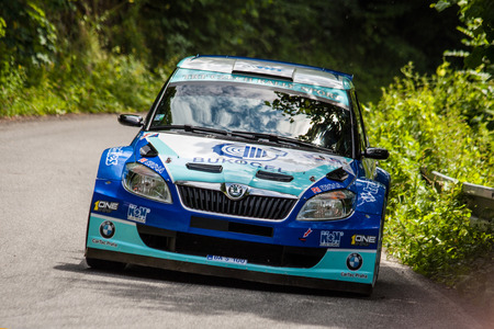 irc: MLADA BOLESLAV, CZECH REP. - JULY 13 : Driver Odlozilik R. and co driver Turecek M. in Skoda Fabia S2000 at speed stage no. 7 during Bohemia Rally July 13, 2013 in Mlada Boleslav, Czech Republic.