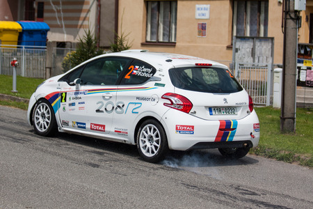 irc: MLADA BOLESLAV, CZECH REP. - JULY 13 : Driver Cerny J. and co driver Kohout P. in Peugeot 208 R2 at speed stage no. 16 during Bohemia Rally July 13, 2013 in Mlada Boleslav, Czech Republic.