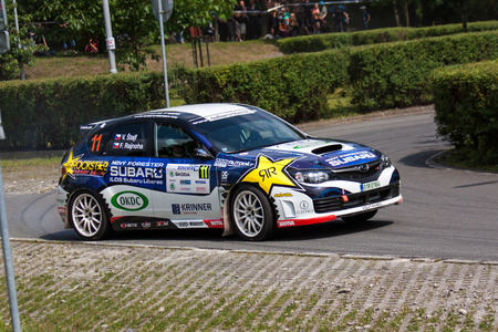 f 18: MLADA BOLESLAV, CZECH REP. - JULY 13 : Driver Stajf V. and co driver Rajnoha F. in Subaru Impreza Sti at speed stage no. 18 during Bohemia Rally July 13, 2013 in Mlada Boleslav, Czech Republic.