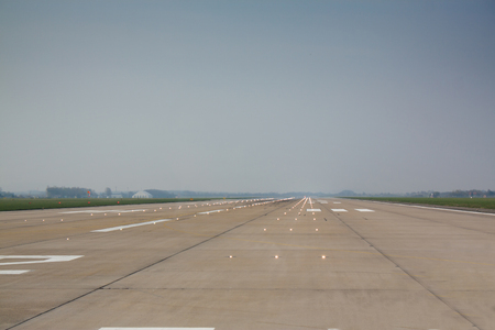 Long and wide runway at the airport photo