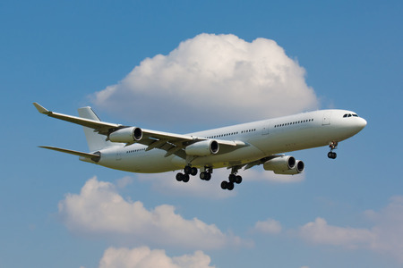 strips away: Huge white plane with four engines on final approach