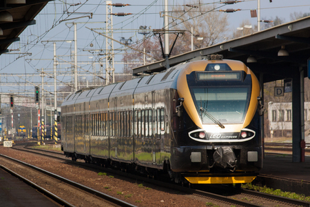 OSTRAVA, CZECH REPUBLIC - APRIL 1: Leo Express train arrive to railway station Osrava on April 1, 2014. LEO Express fleet is composed from low-deck, fully conditioned aerodynamical units.