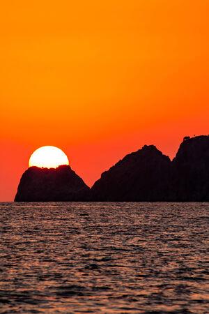 oregon coast: Nice sunset behind the rocky island in Turkey