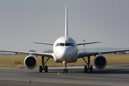 Eye to eye detail of taxing white plane photo