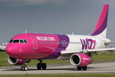 PRAGUE - SEPTEMBER 9: A320 Wizz Air taxi for takeoff for PRG in Prague, CZE on September 9, 2010. Wizz Air is a Hungarian low-cost airline.