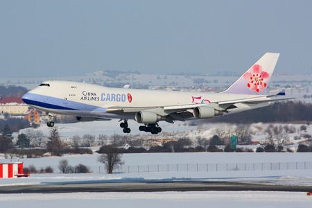 PRAGUE - FEBRUARY 14: China Airlines Cargo B747 airliner approaches for landing on February 14, 20091 in Prague,Czech Republic. It is the flag carrier of the Republic of China - commonly known as Taiwan