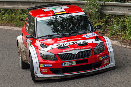 irc: MLADA BOLESLAV, CZECH REP. - JULY 11 : Driver Wiegand S. and co driver Christian F. in Skoda Fabia S2000 at speed stage no. 3 during Bohemia Rally July 11, 2014 in Mlada Boleslav, Czech Republic. Editorial