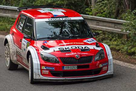 irc: MLADA BOLESLAV, CZECH REP. - JULY 11 : Winners of Rally Bohemia Driver Kopecky J. and co driver Dresler P. in Skoda Fabia S2000 at speed stage no. 3 July 11, 2014 in Mlada Boleslav, Czech Republic. Editorial