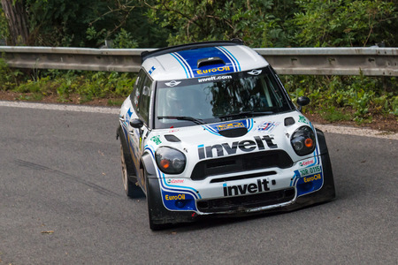 irc: MLADA BOLESLAV, CZECH REP. - JULY 11 : Driver Pech V. and co driver Uhel P. in Mini John Cooper Works S2000 at speed stage no. 3 during Bohemia Rally July 11, 2014 in Mlada Boleslav, Czech Republic. Editorial