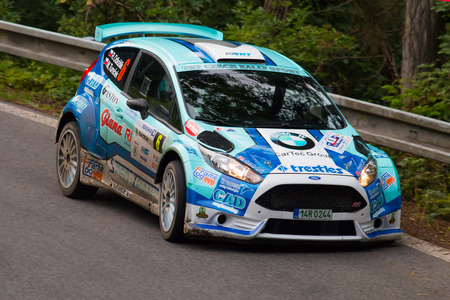 irc: MLADA BOLESLAV, CZECH REP. - JULY 11 : Driver Odlozilik R. and co driver Turecek M. in Ford Fiesta R5 at speed stage no. 3 during Bohemia Rally July 11, 2014 in Mlada Boleslav, Czech Republic.