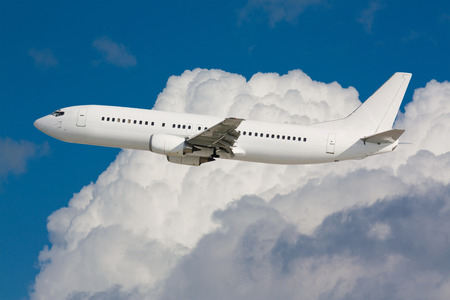 White plane fly with nice cumulus in background