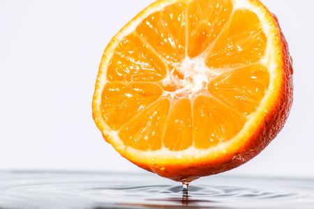 Half of freshness mandarine over the water photo