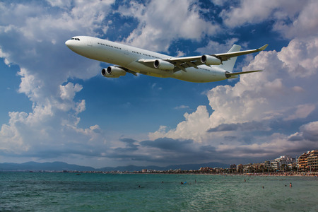 private airplane: Plane flying over the beach during your vacation Stock Photo