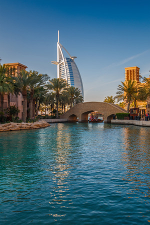 souk: Dubai, UAE - March 29, 2015: View on Burj Al Arab from Madinat Jumeirah. Madinat is a luxury resort which include hotels and souk spreding across over 40 hectars. Editorial