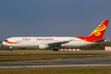 long range: PRAGUE, CZECH REPUBLIC - OCTOBER 6: Boeing 767-300 Hainan Airlines taxi for departure PRG Airport on October 5, 2015. Hainan Airlines is the 4th largest airline in China. Editorial