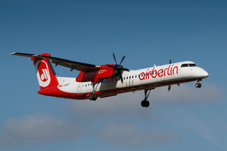 30 s: PRAGUE, CZECH REPUBLIC - AUGUST 30: Air Berlin Bombardier DHC-8 lands at PRG Airport on August 30, 2016.  Air Berlin s Germanys second largest airline