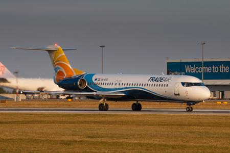 trade off: PRAGUE, CZECH REPUBLIC - SEPTEMBER 11: Trade Air Fokker 100 take off from PRG Airport on September 11, 2016.